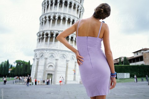 Woman posing infront of Leaning Tower of Pisa. Italy